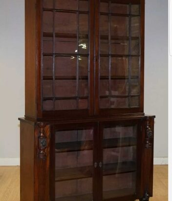 VICTORIAN MAHOGANY BOOKCASE WITH LION MASK, CLAW FEET AND GLASS DOORS