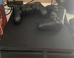 preowned play station 4 pro with two controllers
