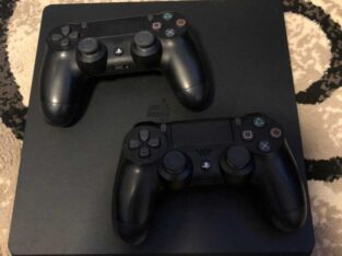 PS4 Console with 2 controllers power cor